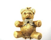 Vintage Max Factor Solid Perfume Pendant - Teddy Bear with Amber Eyes and Rhinestone Bow Embellishments
