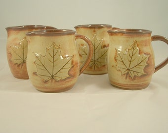 Stoneware Pitcher Creamer  with a real Maple Leaf  in a cream rust glaze perfect for Maple Syrup.