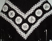Vintage hippie style crochet black poncho wrap shawl with fringe and gray white flowers