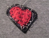 Small stitched heart with zipper and wire edging pin