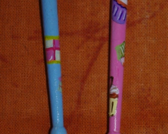 A pair of birch wood bobbins with a cup cake,cookies and cake theme