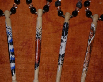 A set of four birchwood lace bobbins with a woodland Feather theme