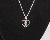 Vintage Sterling Silver necklace with a cross and fish inside a heart