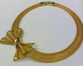 Vintage Givenchy gold mesh bow necklace