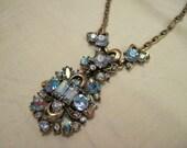 On Reserve - Hollycraft pendant necklace with luminous blue aurora borealis rhinestones