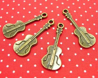 20 pcs Antique Bronze Music Charms Guitar Charms 25x9mm CH0389