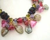 """Flower charm bracelet, beaded. Flower drops, wrapped. Crystal, glass. Purple red green brass. """"Jewelled Garden."""" Flower bead jewelry. B70a."""