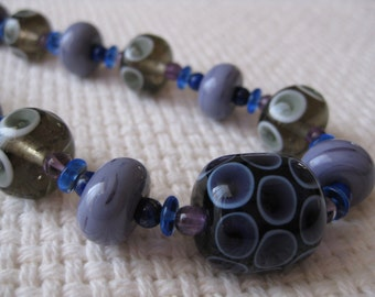 Glass Lampwork Bead Necklace in Deep Purple and Smokey Grey, with Amethysts and Lapis Lazuli.