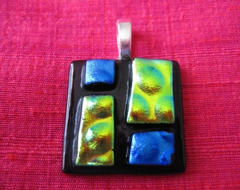 dichroic fused glass pendant in lime/gold and blue on purple.
