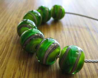 Glass Lampwork Beads, Green and Silver Ivory Spirals.