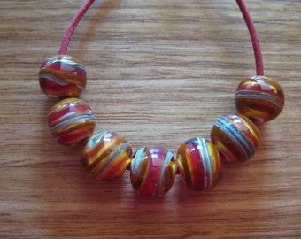 Glass lampwork Beads, Amber with Silver Ivory, Brown and Red Spirals