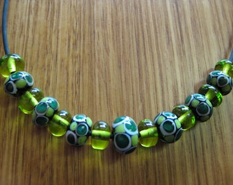 Glass Lampwork Bead Set, Mosaic Dots in Green, Ivory and Black, with Lime Spacer Beads.