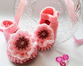 Crocheted children slippers in pink and raspberry, decorated with beautiful flowers