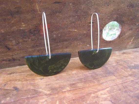 half full of green earrings