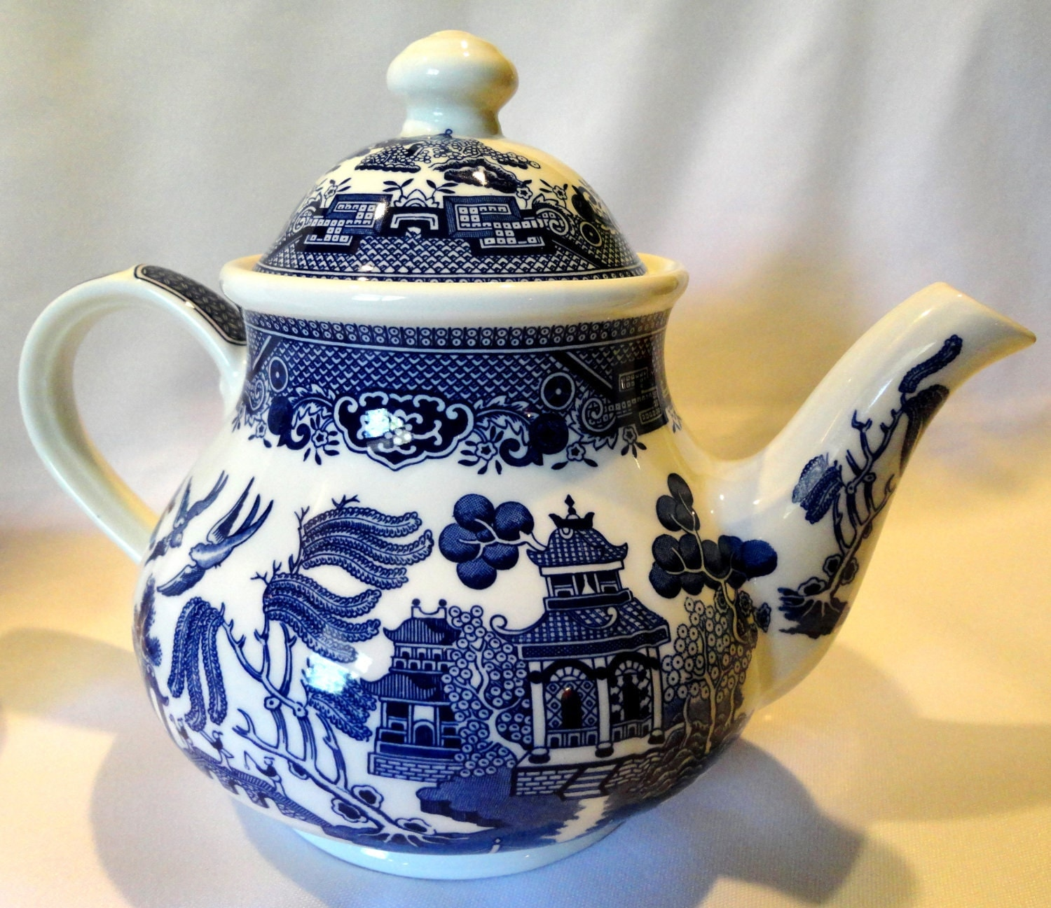 Willow blue china tea pot with lid pattern by churchill