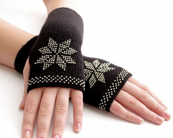 Very soft and cozy merino wool and acrylic blend beaded fingerless gloves/wrist warmers in black with a flower motif