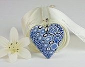 Pretty blue and white heart shaped pendant