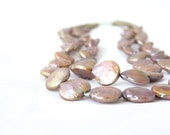 SEED. double strand pearl necklace in pink bronze, gold and sterling silver