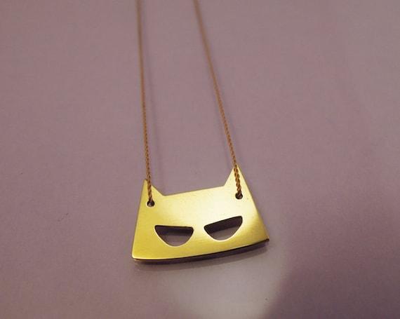 Mask necklace brass