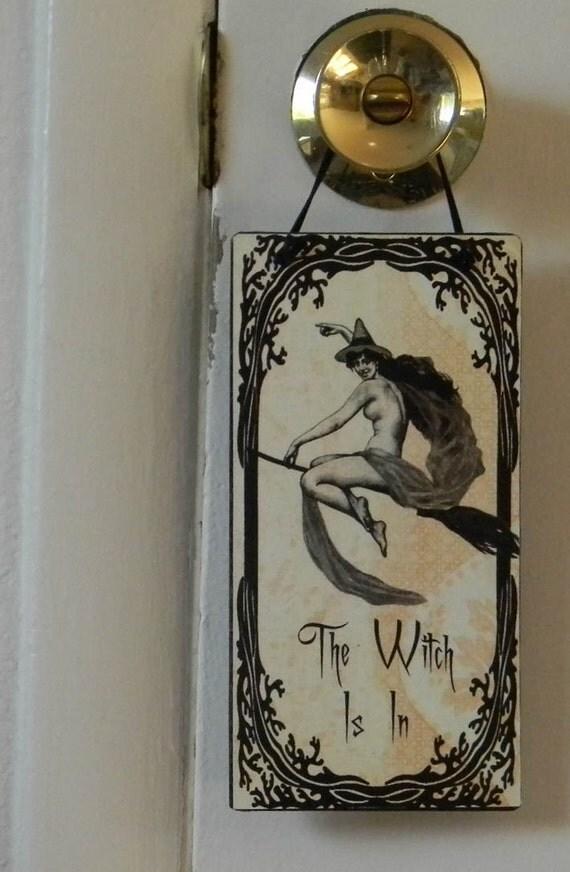 The Witch Is In Door Hanger