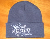 Navy knit hat with Baby its cold outside embroidered