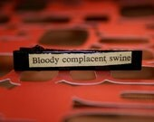 bloody complacent swine- vintage novel snippet on hair clip OOAK