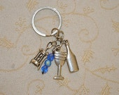 wine lover's keychain  garnished with 3 tibetan silver charms - a cork screw, wine glass and wine bottle.