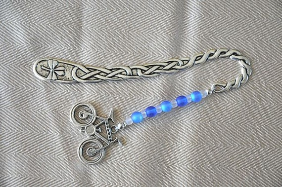 cyclist's bookmark with a celtic flare, large bicycle charm and blue glass beads