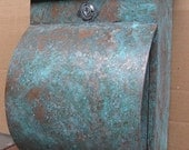 Green patina copper mailbox with newspaper holder
