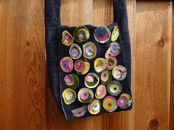 Dot.com: a denim cross-body with colorful fabric dots and buttons