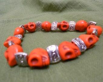 Man's Skull Bracelet Orange Dyed Howlite Man Sized Carved Stone With Tibetan Silver Flat Bead Accents -Dia de los Muertos