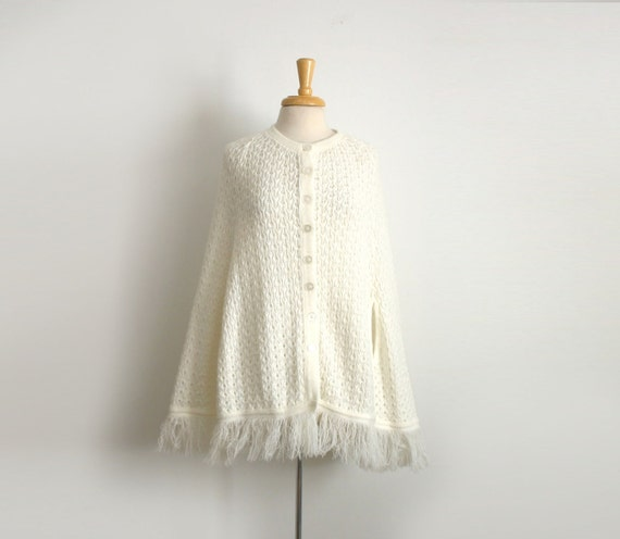 1960s 1970s  Vintage button down knit cape/ poncho in white with fringe