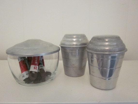Vintage Display/ Storage Collection:  2 - Aluminum Mirro Measuring cups with Lids and a Glass Bowl with Metal Lid