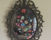 Vintage brass framed oval wall-hanging. Floral paintings on glass. Gothic Revival.