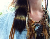 Natural Raccoon or Bobcat Tail Earring on Braided Buckskin