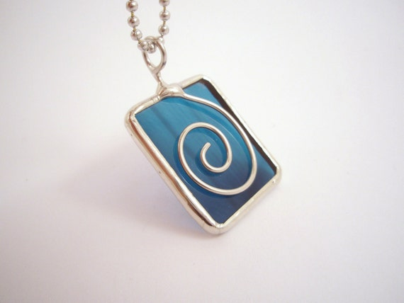 Deep aqua blue stained glass rectangle pendant with wire design