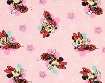 Disney Minnie Mouse Floral Badges on Pink Cotton Fabric by Springs Creative
