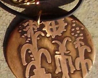 Etched copper petraglyph pendant