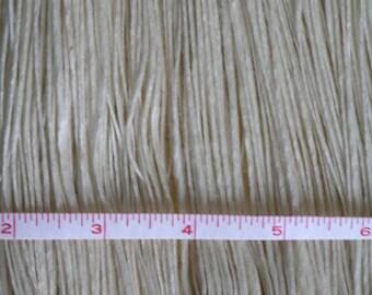 Handspun single ply silk/wool yarn