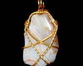 Wire wrapped pendant - Swirly white agate in gold wire