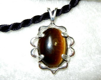 Tiger eye cabachon in sterling silver pendant with black satin choker
