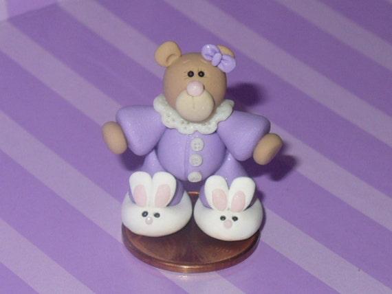 Abigail a Miniature Teddy Bear wearing Bunny Slippers