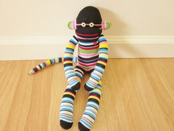 Licorice allsorts sock monkey plush - black, pink, green, blue, yellow, gray, and red stripes