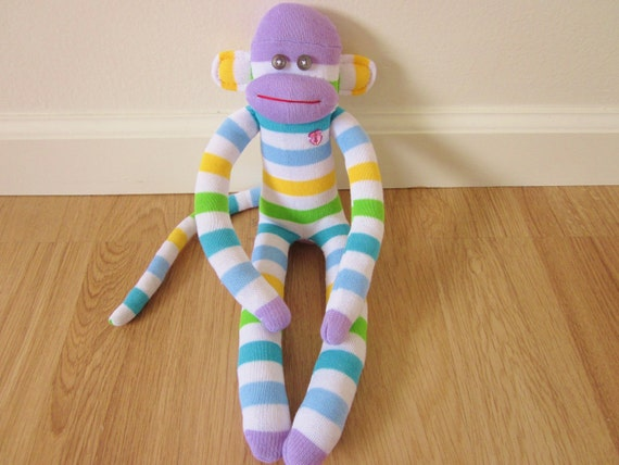 Pastel sock monkey plush doll - lavender, blue, yellow, white, and green stripes with rhinestone heart