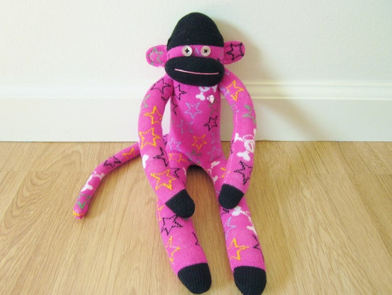 Punk rock sock monkey - magenta and black with colorful stars and skulls