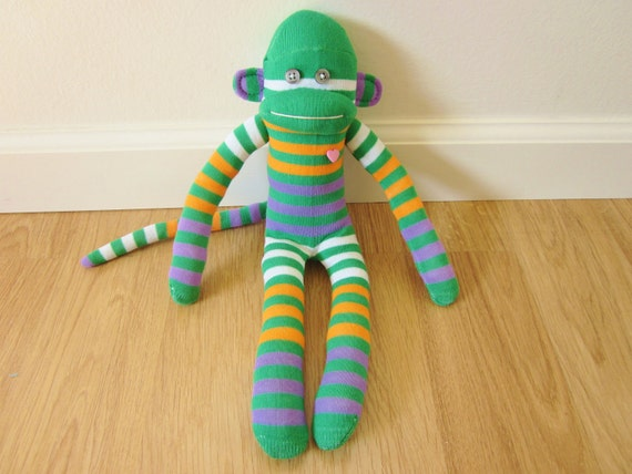 Carrot juice sock monkey plush doll - green, orange, white, and purple stripes