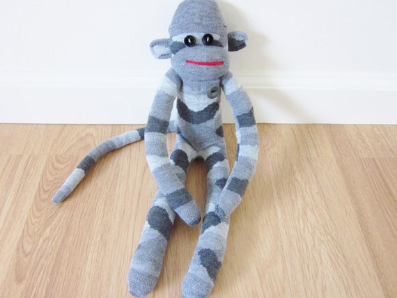 Gray camouflage sock monkey plush toy with gray vintage button