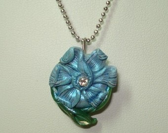 """Blue polymer clay flower with Swarovski crystal center and wrap-around leaves 18"""" necklace"""