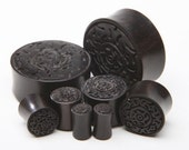 "7/16"" (11mm), 1/2"" (13mm), 9/16"" (14mm), 5/8"" (16mm)  Ebony Wood Plugs with carved design"