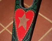 Hand painted boot jack with rusted tin star.